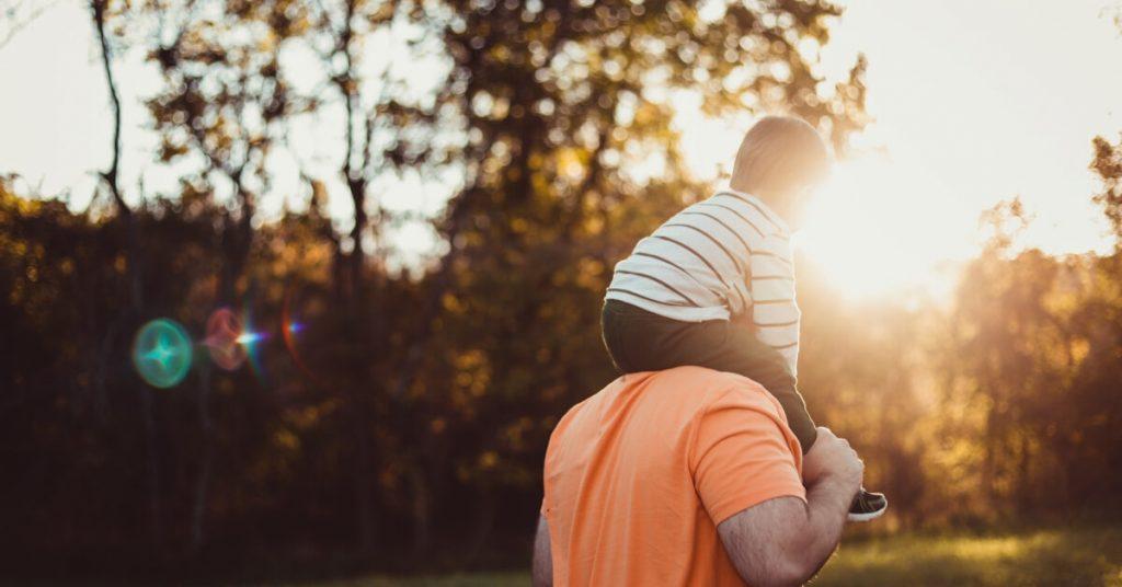 boy on his dad's shoulders