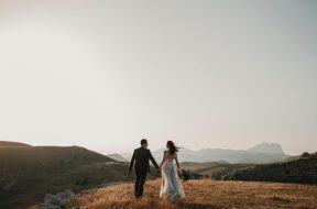 married-couple-walking-in-the-distance-on-hills-2.jpg