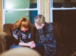 two-women-grieving-on-a-couch-2.jpg