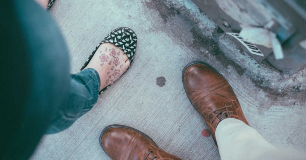 woman and mans feet on pavement