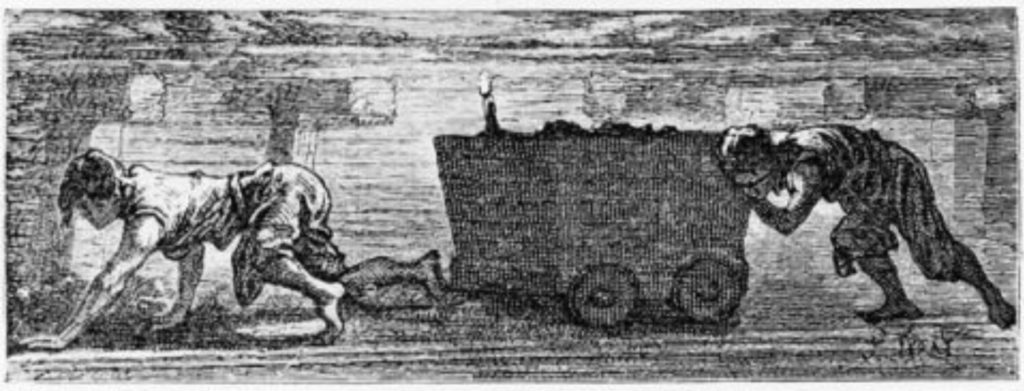children pushing carts underground