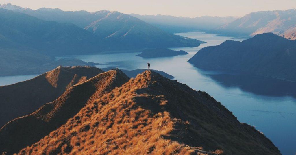 person standing atop a mountain