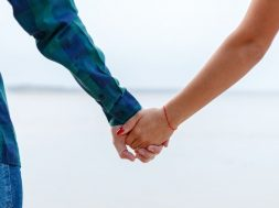 couple-holding-hands-yehor-milohrodskyi-unsplash.jpg
